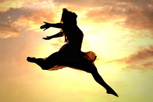 depositphotos_31661587-stock-photo-woman-leaping-at-sunset